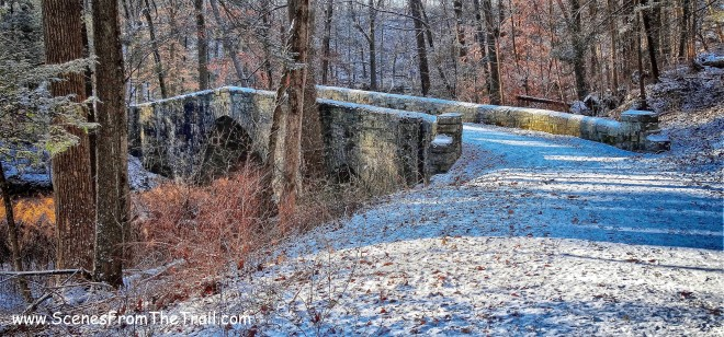 stone-faced triple-arch bridge