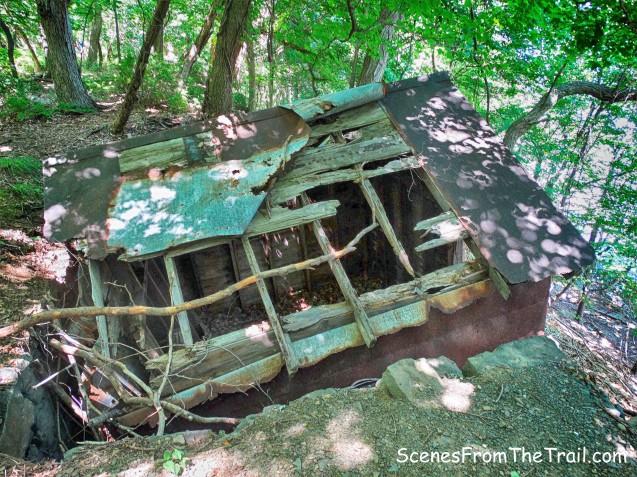 ruined metal shack