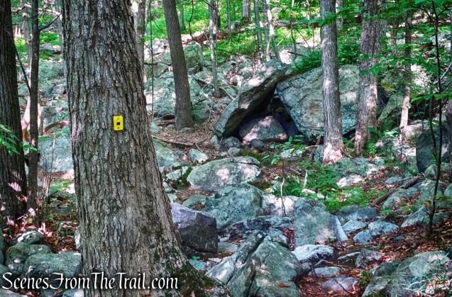 inverted V-shaped rock formation alongside Manaticut Point Spur Trail