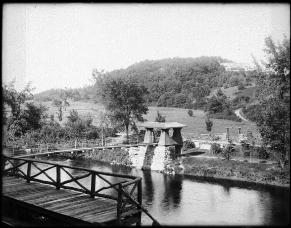 Railroad stop and suspension bridge - From the Collection of the Gunn Memorial Library and Museum