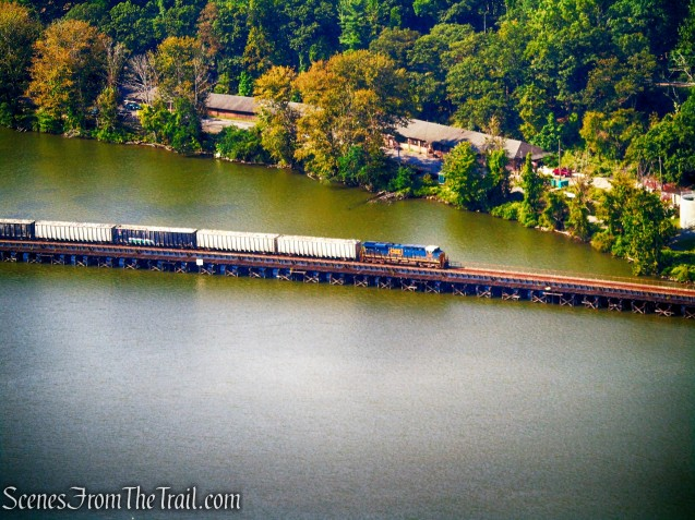 CSX freight train traveling north between Iona Island and the Bear Mountain Bridge